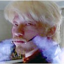 This is from a movie, the cigarette smoke is coming from his cheeks where it has been cut open.