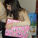 Before profile- opening Christmas presents last year.