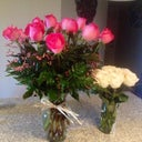 Pretty pink roses from the boo next to my white roses that I picked up myself from the grocery store. Lol