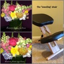 "The ""kneeling"" chair & pics of the flowers my boss sent me. He's such a sweetheart."