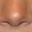 Ideal front view of nostrils, small and not showing very much