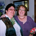 Me and My Bear at our wedding. 9-2-2008  as you can see the purple dress is a bit tight across the breast. Best day ever but the girls are out there.
