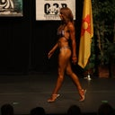Stage photo from July 2011. Profile to show there is a little bit of roundness even though I am trying my hardest to keep it in! The judges do critique me on this, and they always mention my skin in the post interview. :(